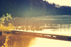 Wooden pier on a lake. In the evening Royalty Free Stock Photo