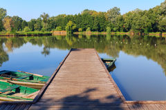 Wooden pier on the lake. In Hungary,Europe Royalty Free Stock Photo