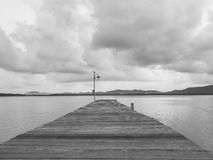 Wooden Pier and lake Landscape nature view. Black and white Stock Image