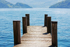 Wooden pier by the lake. Lucerne in Weggis Royalty Free Stock Photo