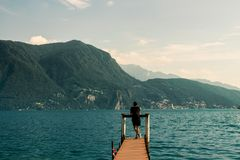 Wooden pier on a lake in Lugano, Switzerland. stock photo