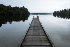 Wooden pier on the lake. In the morning Royalty Free Stock Photos
