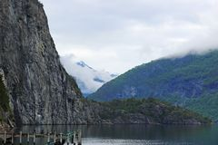 Wooden pier at the lake. In mountains of Norway royalty free stock image