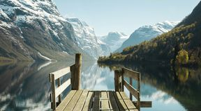 Wooden pier at the lake. In Norway Stock Images