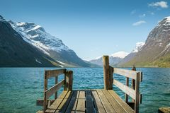 Wooden pier at the lake, Norway. Wooden pier at the lake in Norway Royalty Free Stock Image