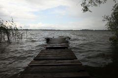 Wooden pier at the lake Royalty Free Stock Photo