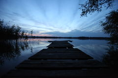Wooden pier at the lake Stock Photos