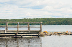 Wooden pier on lake. Old wooden pier on lake Stock Photo