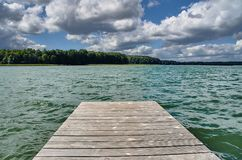 A wooden pier on a lake. In Poland Royalty Free Stock Photo