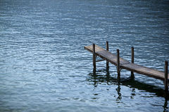 Wooden pier by the lake. Silent place concept Stock Photo