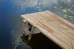 Wooden pier at the lake Stock Photography