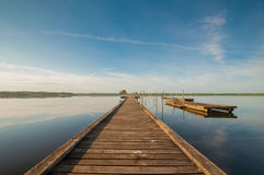 Wooden pier in a lake. Sunrise at Soustons, France Stock Photography
