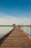 Wooden pier in a lake. Sunrise at Soustons, France Royalty Free Stock Images