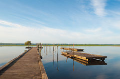 Wooden pier in a lake. Sunrise at Soustons, France. Summer morning Royalty Free Stock Photos
