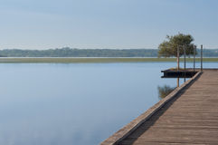 Wooden pier in a lake. Sunrise at Soustons, France. Summer morning Stock Photography