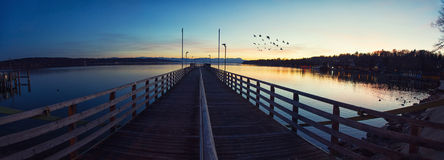 Wooden pier on lake. At sunset Royalty Free Stock Photo