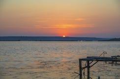 Wooden pier on the lake. Wooden pier on the lake at sunset Stock Photos