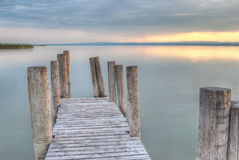 Wooden pier on the lake at sunset Stock Photo