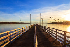 Wooden pier on the lake. And sunset - panorama in bavaria / germany Royalty Free Stock Photos