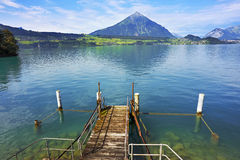 Wooden pier at the lake, Switzerland. Wooden pier at the lake Thun, Switzerland Royalty Free Stock Image