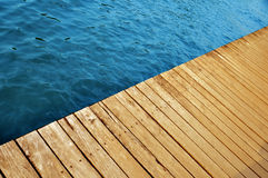 Wooden pier with lake water stock images