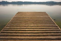 Wooden pier on the lake. In winter Royalty Free Stock Photo