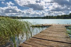 A wooden pier on a lake. In Poland Royalty Free Stock Images