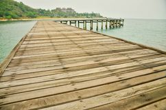 Wooden pier lead into the sea stock photo