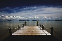 Wooden pier leading in the Andaman sea on tropical island Ko Lanta, Thailand stock image