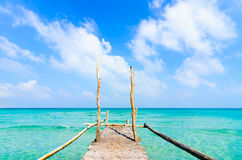 Wooden pier leading to sea on beautiful beach at Nam Du Island Royalty Free Stock Photography