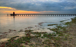 Wooden pier and lighthouse in Lignano Stock Photography