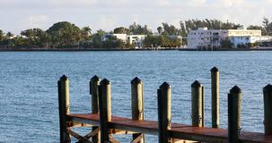 Wooden Pier And Luxury Houses In Miami Beach