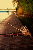 Wooden pier and lying it the rope Royalty Free Stock Photos