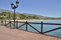 Wooden pier in Marbella Royalty Free Stock Photo