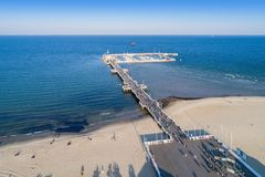 Wooden pier with marina in Sopot resort, Poland. Aerial view. Sopot resort in Poland. Wooden pier molo with marina, yachts, beach, walking people, vacation Stock Photo