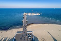 Wooden pier with marina in Sopot resort, Poland. Aerial view. Sopot resort in Poland. Wooden pier molo with marina, yachts, beach, walking people, vacation Stock Images