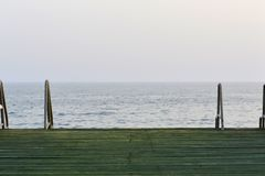 Wooden pier with metal handrails Royalty Free Stock Photography