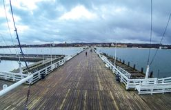 Wooden pier Molo in Sopot city, Poland. People walking on a pier Molo in Sopot city, Poland. Built in 1827 with 511m long it is the longest wooden pier in Europe stock photography