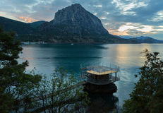 Wooden pier and Mount Falcon near village Novyi Svit in Crimea. Stock Images