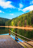 Wooden pier on mountain Lake in Synevir National Park Royalty Free Stock Image