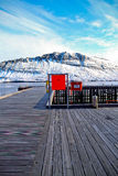 Wooden Pier with mountain view Stock Photo