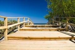 Wooden pier near beach Royalty Free Stock Photo