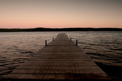 Wooden pier near water edge Royalty Free Stock Images