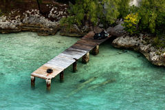 Wooden pier. A nice beach and sea view in bahamas, a view of wooden pier and a nice green sea Royalty Free Stock Photo