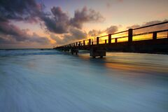 Wooden Pier on Ocean Waves Royalty Free Stock Photography