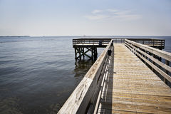 Wooden Pier & Oil Booms, Gulf Coast Royalty Free Stock Photos