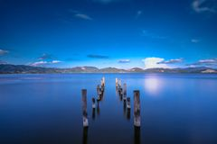 Free Wooden Pier Or Jetty Remains On A Blue Lake Sunset And Sky Reflection On Water. Versilia Tuscany, Italy Stock Images - 103435794