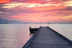 Wooden Pier with the orange sunset background, Golden sky, Red sky. The Wooden Pier with the orange sunset background, The Orange sky or golden sky or Red sky at Royalty Free Stock Photo