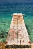 Wooden pier over beautiful adriatic sea. Korcula, Croatia Stock Images