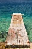 Wooden pier over beautiful adriatic sea. Korcula, Croatia Stock Images